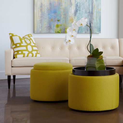 Living room scene with View showing tray of Uno Storage Round Ottoman in yellow fabric by American Leather at Creative Classics Furniture in Alexandria VA near Arlington VA and Washington DC