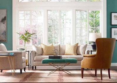image of living room with teal green accents