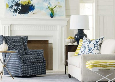 image of neutral living room with blue and yellow accents