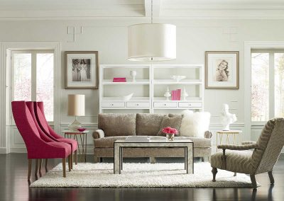 image of neutral living room with pink accents