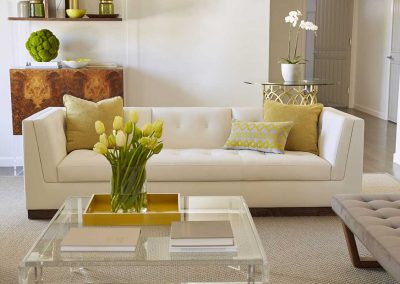 image of neutral living room with yellow and green accents
