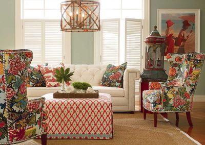 image of living room with botanical and red accents